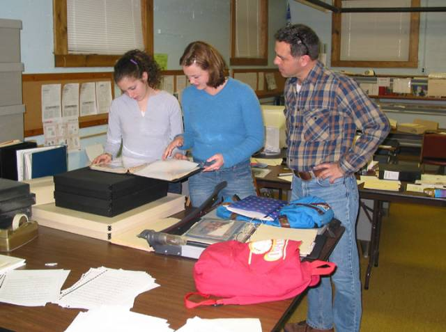 Paul McLeod works with students to select archival images for the next museum exhibit.