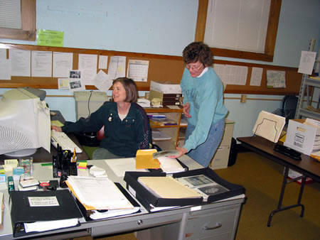 Janet Geronime and Pat Juday at work organizing archival images.